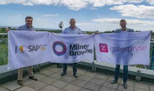 3 Men Holding Flags Of SAP Business One, Milner Browne, And Enterpryze